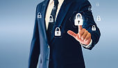 Businessman touching padlock virtual button. Concept of success business or security.