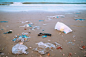 Trash, plastic, garbage, bottle, bag... environmental pollution on sandy beach