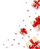 Gift box with red ribbon and heart on white background.