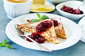 French toast with cherry sauce.