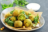 Fresh falafel balls on a dark background.