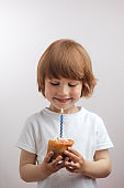 smiling pleasant kid has got a cake on birthday