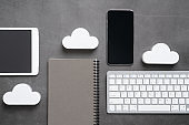 Cloud technology icon for global business concept on a desk from top view