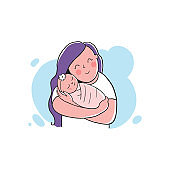 A mother holding a baby.