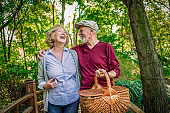 cheerful senior couple going for picnic