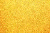 gold colored glitter paper abstract or vintage texture background
