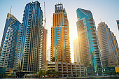 UAE United Arabs Emirates. Dubai marina skyscrapers at sunset. Apartments, hotels and office buildings, modern residential development of UAE