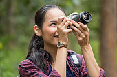Photographer woman asian woman taking a photos with dslr camera professional photography during her vacation, Concept of woman solo travel
