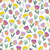 Seamless floral pattern with tulips and strawberry on white background