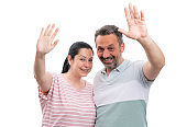 Couple waving as greeting gesture