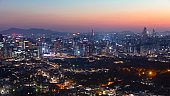 Sunset Seoul City Skyline and Seoul Tower in Seoul  South Korea