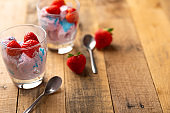 Ice cream with strawberries on wooden background.Flat lay.Summer mood