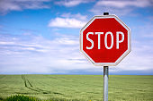 Stop road sign over blue sky
