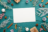 Christmas composition, frame, snow-covered branches of a Christmas tree. Cones. Giving with gifts. Atmosphere. New Year and holiday. Flat lay