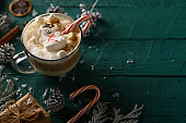 Christmas composition, hot coffee with marshmallows and a New Year`s snowman. Horizontal photo, with space