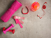 pink dumbbells, bottle of water, fitness tracker, elastic bands