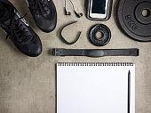 Closeup on laying on the floor black sneakers, headphones, fitne