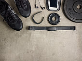 sneakers, fit tracker, hear rate monitor, phone, weight plates