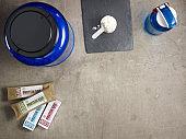 big blue protein jar, shaker, measuring spoon, raw protein bars
