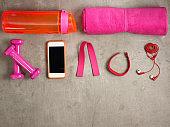 dumbbells, bottle of water, tracker, elastic band, smartphone
