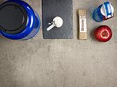 big protein jar, shaker, measuring spoon, raw protein bar, apple