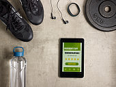 tablet PC with workout app offer to share result in social media