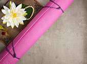 tray with fragrant stuff for aroma yoga, beads, yoga mat