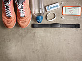 sneakers, raw protein bar, smartphone with heart rate app.