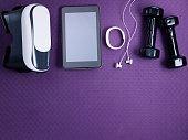 VR glasses, tracker, headphones, tablet PC and black dumbbells