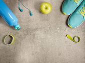 apple, headphones, elastic band, fit tracker, bottle of water