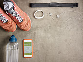 smartphone with gps activity tracking app laying on the floor