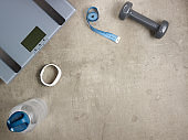 weight scales, fitness tracker, bottle of water, tape measure