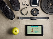 sneakers, hear rate monitor and tablet PC with fitness app