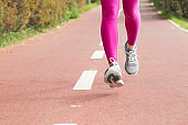 Close-up of female runner practicing outdoors
