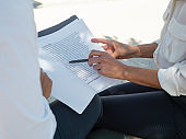 Female business colleagues examining contract text