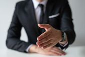 Closeup of business man offering hand for handshake