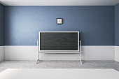 Blue classroom with empty chalkboard
