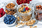 healthy banana granola and breakfast ingredients on white table