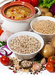 brown rice and quinoa and fresh ingredients for soup, vertical