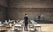 Businessman in contemporary classroom