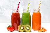 variety of fresh juices in bottles, closeup