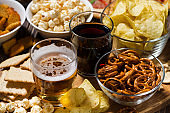 beer and an assortment of snacks, top view