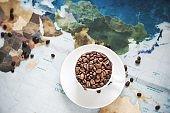roasted coffee bean on vintage world map