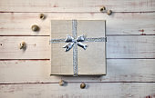 Gift box with bow on a wooden background