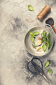 Herbs and spices on concrete background - top view, copyspace