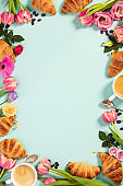Morning coffee, croissants and a beautiful flowers. Flat lay