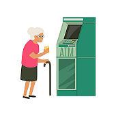 Senior withdrawing money from credit card at ATM.