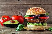 Portobello mushroom vegan burger against a dark wood background