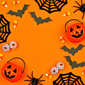 Halloween decor square frame over an orange background with copy space
