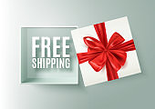Free shipping message in open realistic gift box with red ribbon, vector illustration